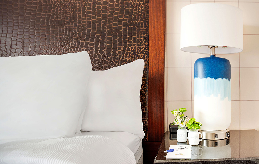 ADA King Bedroom bedside table and lamp at Hotel Lulu Anaheim